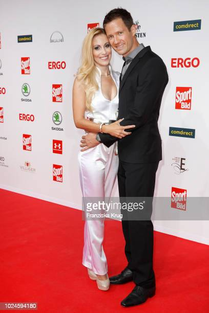 Presenter Andrea Kaiser and her husband Sebastien Ogier attend the Sport Bild Award on August 27 2018 in Hamburg Germany