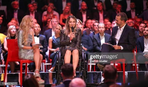 Presenter Andrea Kaiser , Kristina Vogel and Presenter Matthias Bruegelmann during the Sport Bild Award 2019 at the Fischauktionshalle on August 19,...