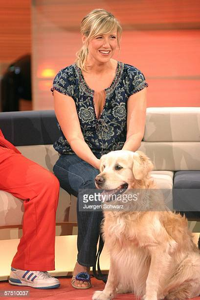 Presenter Andrea Kiewel sits behind her dog Milo at the Sat1 TV show Der grosse Haustiertest set May 1 2006 in Cologne Germany