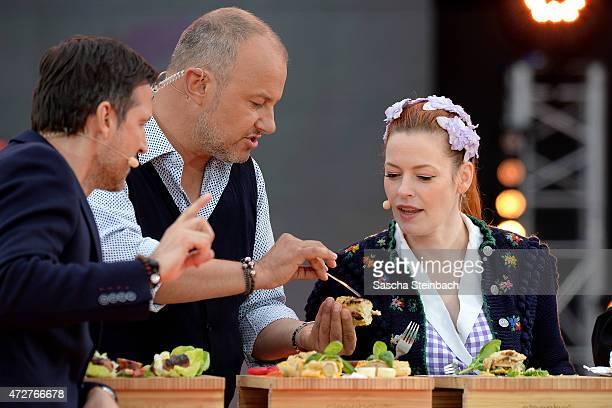 Presenter Andreas Tuerck, Frank Rosin and Enie van de Meiklokjes attend the taping of the tv show 'Abenteuer Grillen - Der kabel eins BBQ-King 2015'...