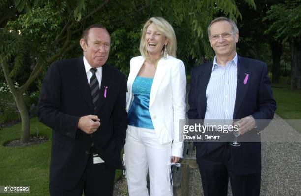 Presenter Andrew Neil, actress Fiona Macpherson and Lord Jeffrey Archer attend the Kit-Kat Club garden party, founded by Ghislaine Maxwell, to help...