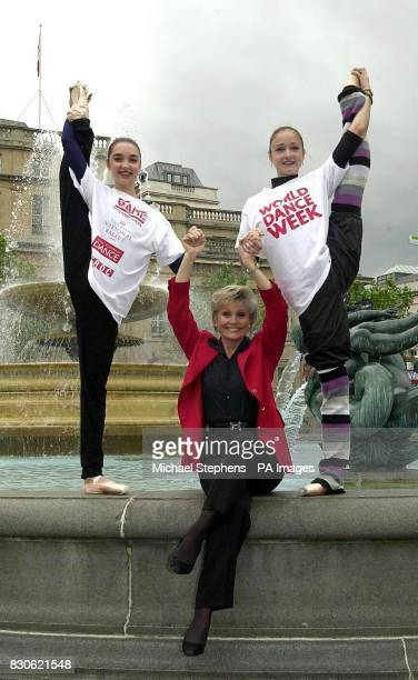 TV presenter Angela Rippon helps dancers Caroline Duprot and Adela Ramirez of the English National Ballet to promote World Dance Week in Trafalgar...