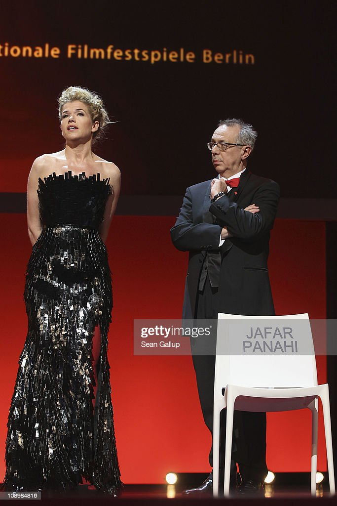 Presenter Anke Engelke (wearing Le Ver Couture) and festival director Dieter Kosslick attend the grand opening ceremony during the opening day of the 61st Berlin International Film Festival at Berlinale Palace on February 10, 2011 in Berlin, Germany.