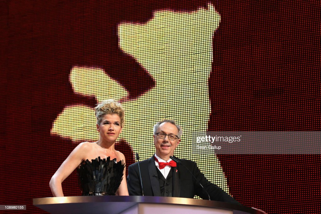 Presenter Anke Engelke and festival director Dieter Kosslick speak during the grand opening ceremony during the opening day of the 61st Berlin International Film Festival at Berlinale Palace on February 10, 2011 in Berlin, Germany.