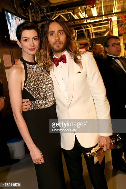 Presenter Anne Hathaway and best Supporting Actor winner Jared Leto pose backstage during the Oscars held at Dolby Theatre on March 2 2014 in...
