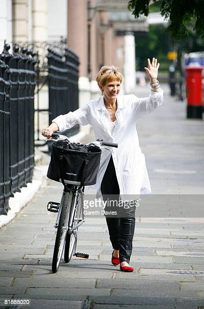 TV presenter Anne Robinson pushes her bycycle as she leaves her home in Kensington July 10 2008 in London England Robinson has been banned from...