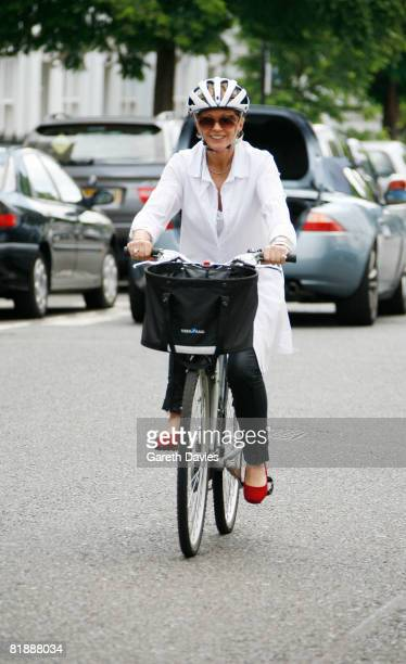 TV presenter Anne Robinson rides her bycycle as she leaves her home in Kensington July 10 2008 in London England Robinson has been banned from...