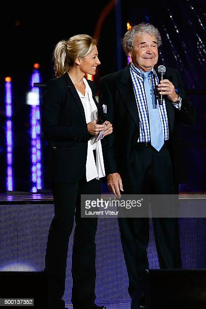 Presenter AnneSophie Lapix and Singer Pierre Perret attend the 'France Television Telethon 2015'Marc Lavoine at Hippodrome de Longchamp on December 5...