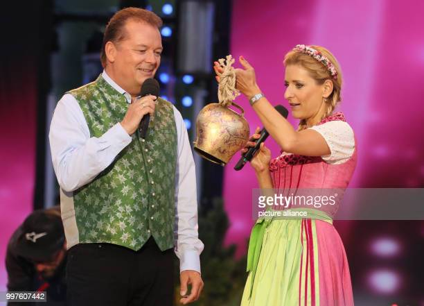 Presenter Arnulf Prasch and German Folk Musician Stefanie Hertel who holds a cowbell can be seen during the final rehearsal of the Summer Open Air...
