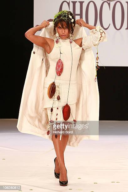 Presenter Audrey Chauveau dressed by Philippe Pascoet and Ute Auwater walks the runway at the Salon Du Chocolat 2010 Opening Night at the Parc des...