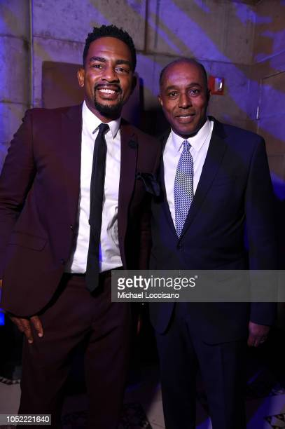Presenter Bill Bellamy and Honoree Jeffrey Harleston pose for a photo on stage during The TJ Martell Foundation 43rd New York Honors Gala at Cipriani...