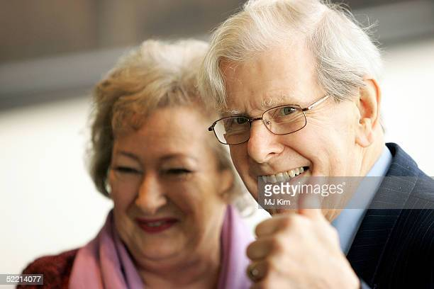 """Presenter Bob Holness with his wife arrive at the """"Norman At Ninety"""" Tribute Luncheon at the Royal Lancaster Hotel on February 18, 2005 in London...."""