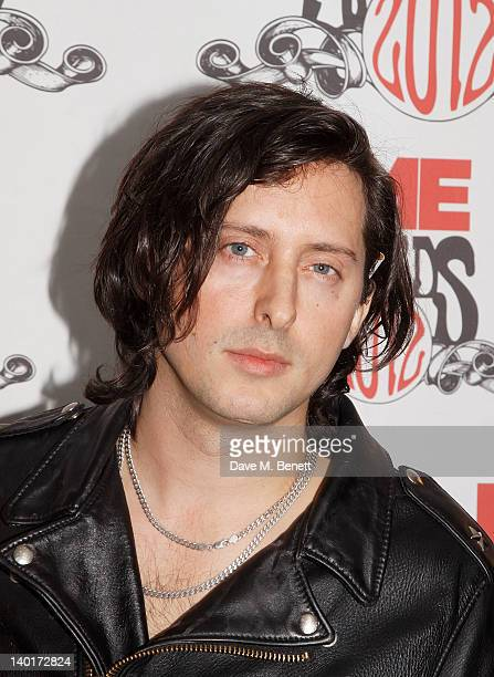 Presenter Carl Barat poses in front of the winners boards at the NME Awards 2012 held at the Brixton Academy on February 29 2012 in London England