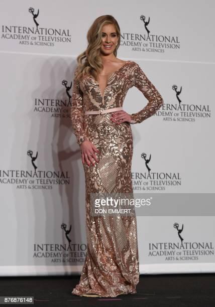 Presenter Carmen Aub poses at the 45th International Emmy awards gala in New York city on November 20 2017 The International Emmy Award is an award...