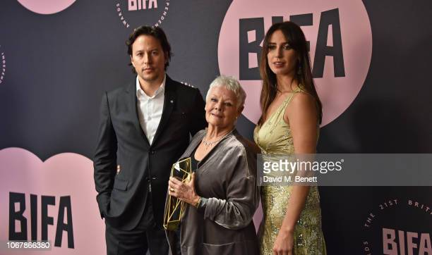 Presenter Cary Fukunaga winner of The Richard Harris Award for Outstanding Contribution by an Actor to British Film Dame Judi Dench and presenter...