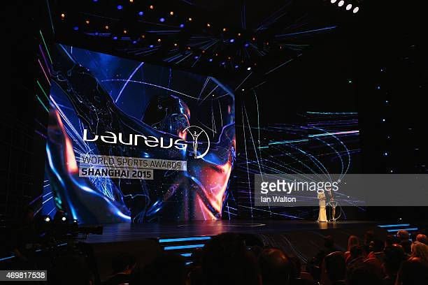 Presenter Chen Chen and host Benedict Cumberbatch speak during the 2015 Laureus World Sports Awards show at the Shanghai Grand Theatre on April 15...