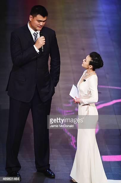 Presenter Chen Chen speaks with former Basketball player Yao Ming of China during the 2015 Laureus World Sports Awards show at the Shanghai Grand...