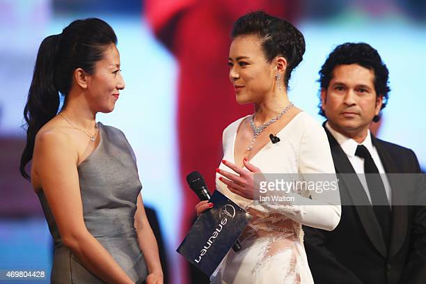 Presenter Chen Chen speaks with Laureus World Sports Academy member Yang Yang during the 2015 Laureus World Sports Awards show at the Shanghai Grand...
