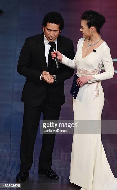 Presenter Chen Chen speaks with new Laureus Academy member Sachin Tendulkar during the 2015 Laureus World Sports Awards show at the Shanghai Grand...