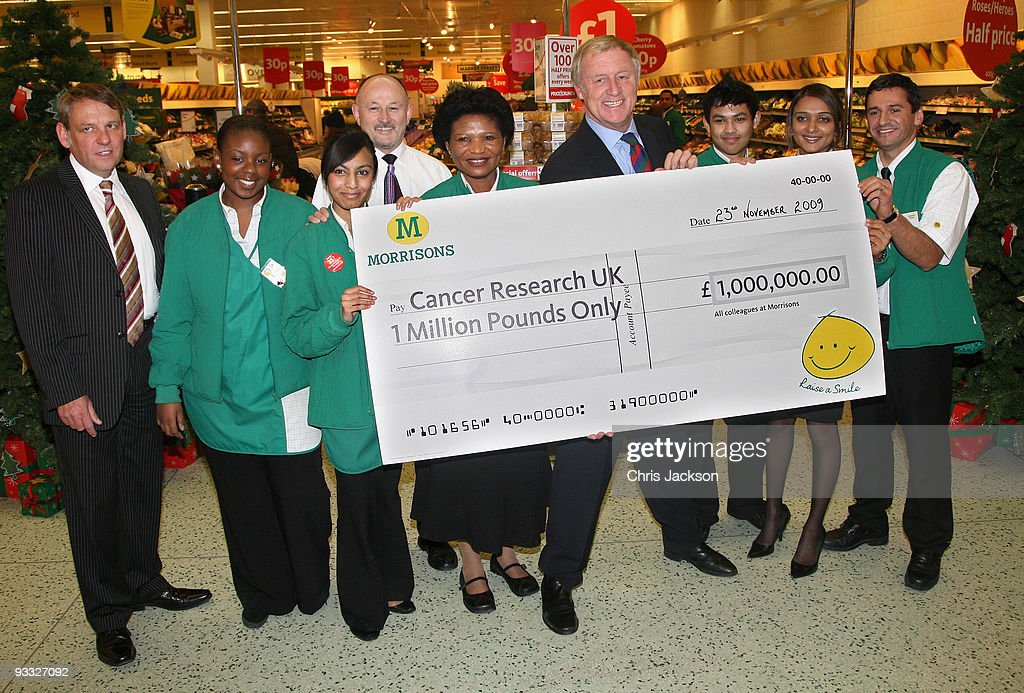 TV presenter Chris Tarrant holds a Million Pound cheque on behalf of Cancer Research UK, at Camden Morrisons on November 23, 2009 in London, England. Morrisons have chosen Cancer Research UK for their charity for 2009.