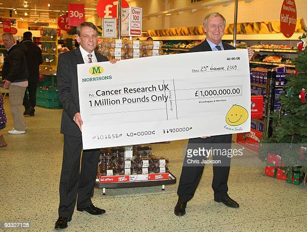 TV presenter Chris Tarrant holds a Million Pound cheque on behalf of Cancer Research UK at Camden Morrisons on November 23 2009 in London England...