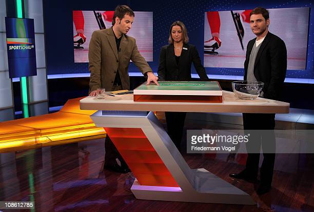 Presenter Claus Lufen, Inka Grings and Daniel Bruehl are seen during the draw for the DFB Cup 2011 Semi Finals during the German Sunday Sports TV...