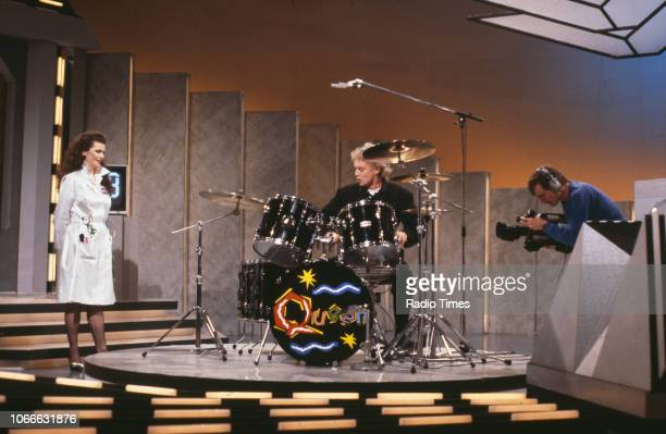 Presenter Cleo Rocos and a drummer filming a segment for the BBC television show 'Brainstorm' December 23rd 1987