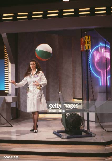 Presenter Cleo Rocos demonstrating a science experiment for the BBC television show 'Brainstorm' December 23rd 1987