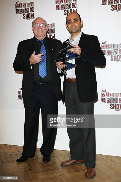 Presenter Clive James poses with Mohsin Hamid winner of the Literature prize during the South Bank Show Awards 2008 at The Dorchester on January 29...