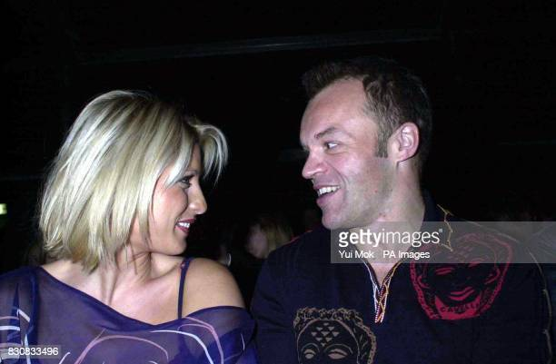 TV presenter Dani Behr and comedian Graham Norton attend the autumn/winter collection by Welsh fashion designer Julien Macdonald on the fifth day of...