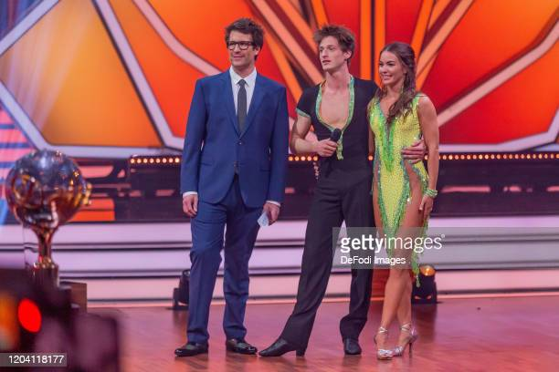 presenter Daniel Hartwich professional dancer Renata Lusin and Moritz Hans looks on during the 1st show of the 13th season of the television...