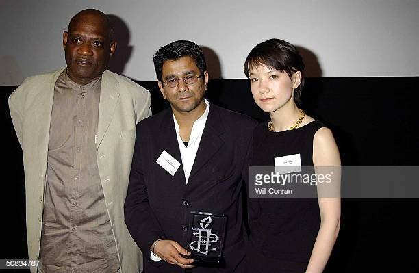 Presenter Darcus Howe with Periodicals Winners Vikram Dodd and Tania Branigan attend the 'Amnesty International Media Awards' at BAFTA Piccadilly on...
