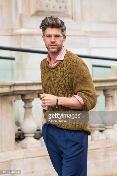 Presenter Darren Kennedy wears a Dak's jumper trousers and shirt and Specsavers William glasses during London Fashion Week February 2020 on February...