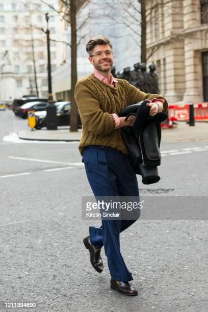 Presenter Darren Kennedy wears a Dak's jumper trousers shoes and shirt and Specsavers William glasses during London Fashion Week February 2020 on...