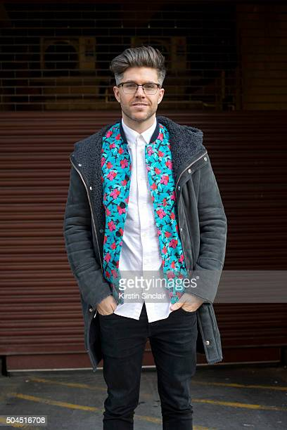 TV presenter Darren Kennedy wears a Whistle coat Richard James jacket H and M shirt and Acne Studios jeans on day 3 of London Collections Men on...
