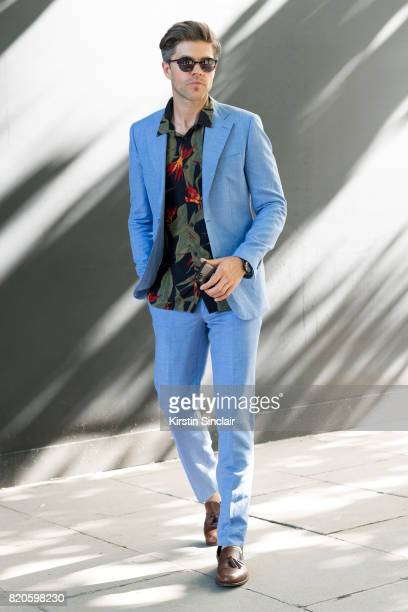 Presenter Darren Kennedy wears H and M suit and shirt Armani watch Specsavers sunglasses and Massimo Dutti shoes on day 3 of London Collections Men...
