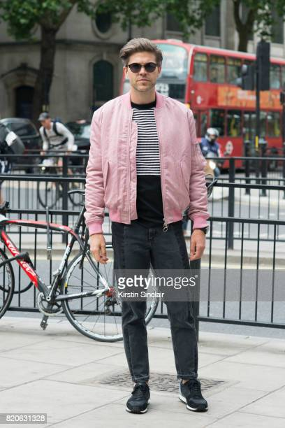 TV presenter Darren Kennedy wears Kurt Geiger trainers Soul Land jacket H and M jumper Acne jeans and Specsavers sunglasses on day 3 of London...