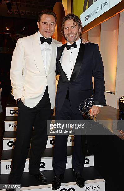 Presenter David Walliams and John Bishop winner of the Modedian of the Year award attend the GQ Men Of The Year awards in association with Hugo Boss...