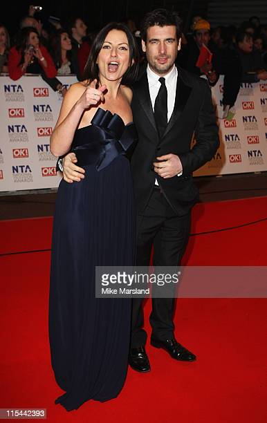 Presenter Davina McCall and husband Matthew Robertson attend the 15th National Television Awards held at the O2 Arena on January 20 2010 in London...