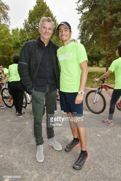 TV presenter Denis Brogniart from Koh Lanta and former Koh Lanta Season 10 contestant Claude Dartois attend the Triathlon des Roses Press Conference...
