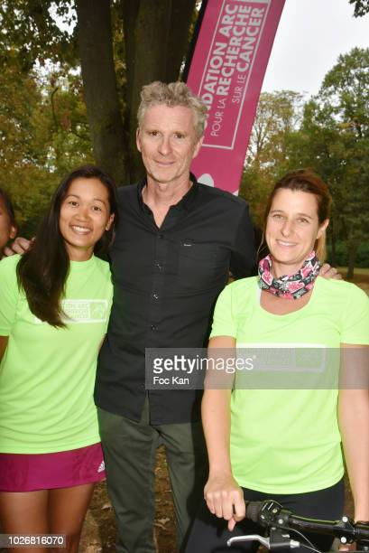 TV presenter Denis Brogniart from Koh Lanta and Triathlon des Roses Association Against Cancer competitors attend the Triathlon des Roses Press...