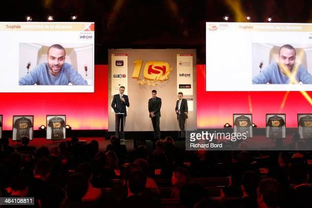 Presenter Denis Brogniart Olympic athlete Tony Estanguet and Sporsora President Laurent Damiani attend the 'Trophees Sporsora Du Marketing Sportif'...