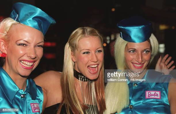 TV presenter Denise Van Outen joins a pair of 'Barbie Girls' outside the British film premiere of Toy Story 2 at the Warner Village Cinema in...