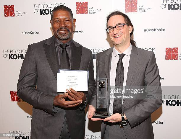 Presenter Dennis Haysbert and Production Designer Todd Cherniawsky receives the award for Excellence in Production Design for a Commercial or Music...