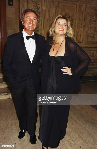 TV presenter Des O'Connor and partner Jodie Brooke Wilson arrive at the 10th Anniversary National Television Awards at the Royal Albert Hall on...