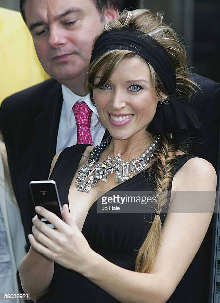Presenter Eamonn Holmes and singer Dannii Minogue attend the launch of the new Sky TV service available on Vodafone live! handsets, at Gloucester...