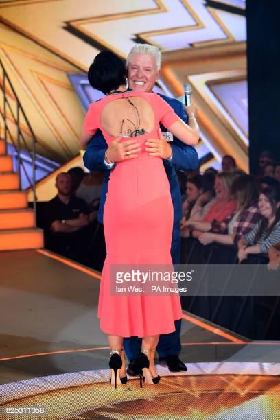 Presenter Emma Willis hugs Derek Acorah as he enters the Celebrity Big Brother house at Elstree Studios in Borehamwood Herfordshire
