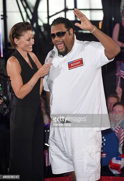Presenter Emma Willis with Fatman Scoop who enters the Celebrity Big Brother house at Elstree Studios on August 27 2015 in Borehamwood England