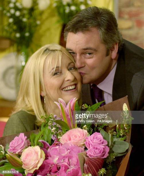 GMTV presenter Fiona Phillips receives a bouquet of flowers from cohost Eamonn Holmes during the show It was her last prgramme before she takes...