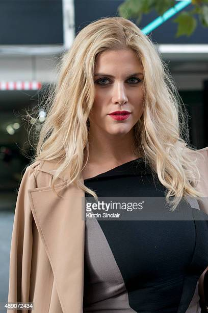 Presenter former Made in Chelsea star Ashley James wears an Oasis jacket and Fyoder Golan dress on day 1 during London Fashion Week Spring/Summer...